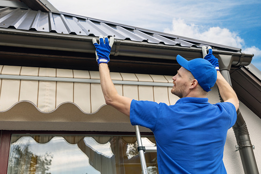 professional installing roof gutter